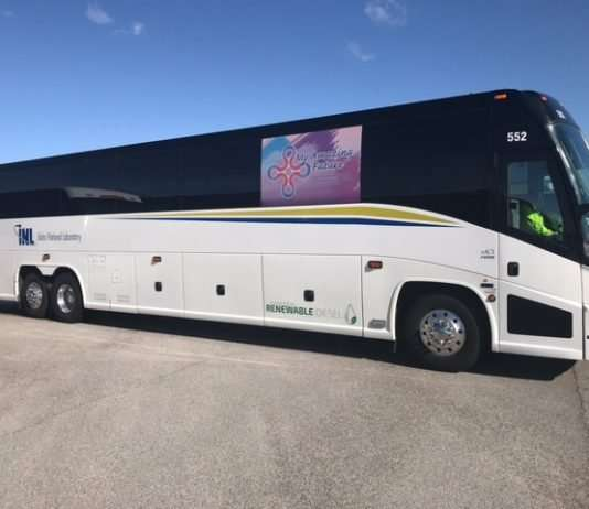 One of the MCI Motorcoaches that is being fueled with renewable diesel at INL (notice the fuel sticker towards the bottom of the white part of the bus).