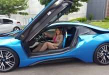 Tammie Cooper learns about a BMW i8 during the recent Live Electric Ride and Drive.