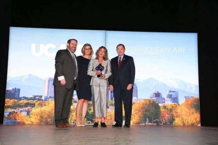 Utah Clean Cities accepting the UCAIR Clean Air Community Partner of the Year award.