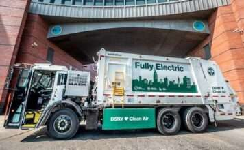 The new New York City Department of Sanitation all-electric garbage truck sit in from of a building during Climate Week New York 2020.