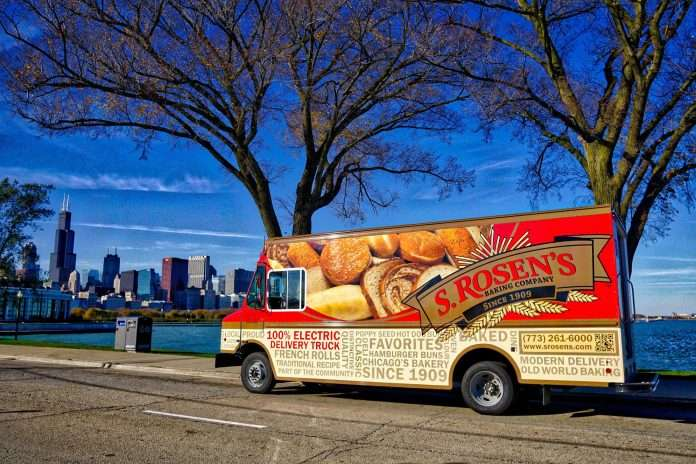 Large red and tan delivery truck with bread imagery and