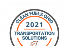 """Gray, blue, orange, and white round logo with text around the circle. """"Clean Fuels Ohio 2021 Transportation Solutions Showcase"""" with small leaf design in the middle"""
