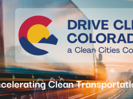 """Drive Clean Colorado new navy blue text logo with red, yellow and blue abstract logo to the left. White text at the bottom, """"Accelerating Clean Transportation"""""""